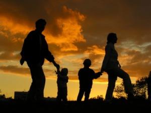 iStock_family walking sunset